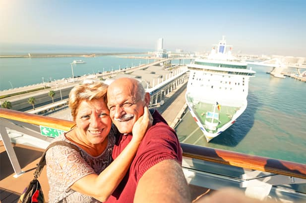 Game-loving couple playing photo scavenger hunt on their cruise ship holiday