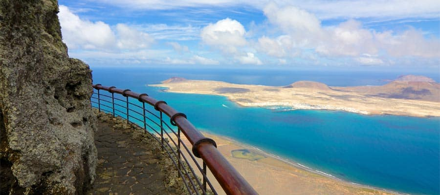 Volcanic coastline and Isla Graciosa on your Arrecife cruise