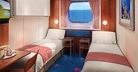 Norwegian Dawn cruise ship Oceanview Stateroom with two beds and picture window.