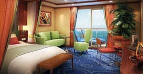 Norwegian Dawn cruise ship Romance Suite with living area, private balcony, dini