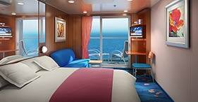 Norwegian Gem cruise ship Balcony Stateroom with floor-to-celling glass doors an