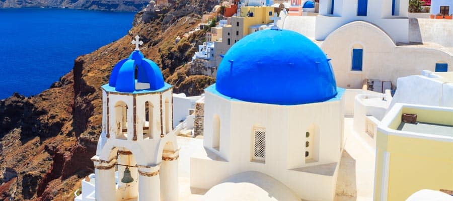 Famous blue domed churches on a Santorini cruise