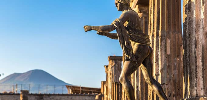 Explore the ruins of Pompeii below the shadow of massive Mt Vesuvius