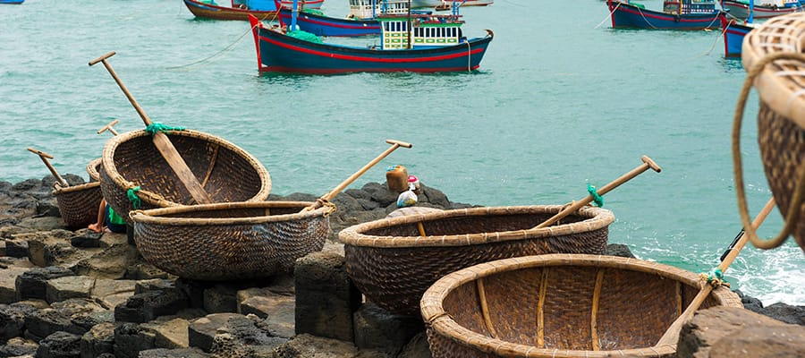 Coracles in polygonal basalt rocks  on Cruises to Nha Trang