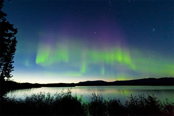 Witness the breathtaking view of the Northern Lights over Alaska