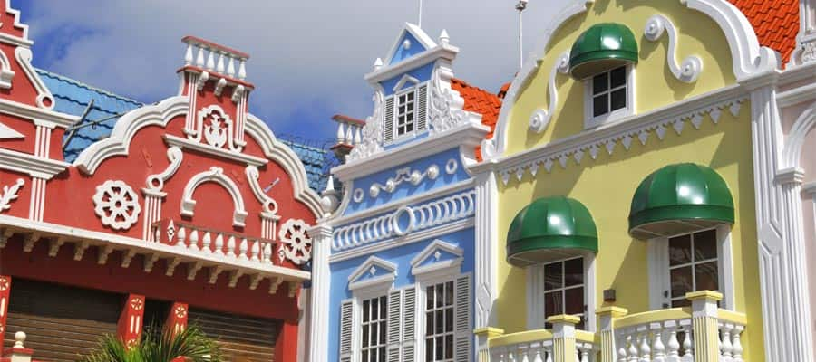 Pastel coloured buildings in a Oranjestad cruise