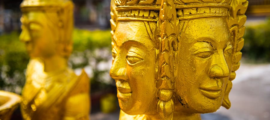 Golden Buddhist Statues on your cruise to Sihanoukville