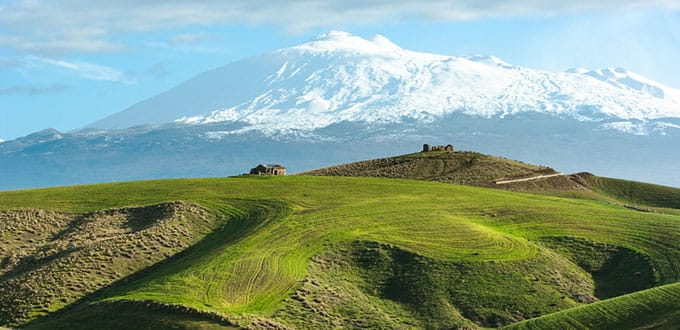 The majestic Mt Etna dominates the rolling hills of Sicily