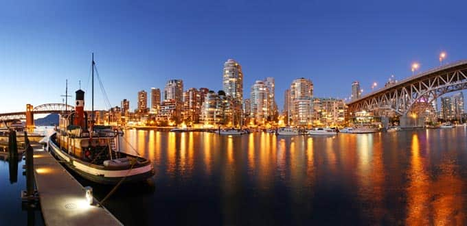 See downtown Vancouver illuminate the city coast
