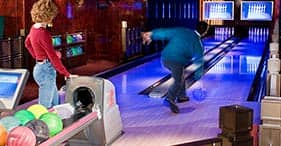 Norwegian Pearl cruise ship guests bowling.