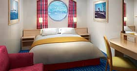 Norwegian Sky cruise ship Oceanview Stateroom with two beds, sitting area, and p