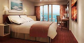 Norwegian Spirit cruise ship Balcony Stateroom with two beds, sitting area, and