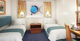 Norwegian Spirit cruise ship Oceanview Stateroom with two beds and porthole.